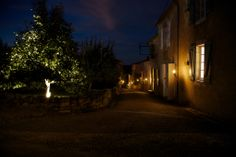 Lighitng that is supplied by village at night.  Add lanterns to street & tea lights from trees.