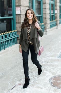 Glitter & Gingham. Leopard blouse+black coated skinny jeans+black ankle boots+olive draped faux leather jacket+blush shoulder bag+gold jewelry. Winter Smart Casual Outfit 2017
