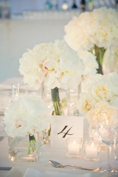 Pretty table setting | I love the look, could modify it by adding a touch of whatever color we decide into the flowers.