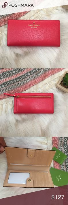 """Kate Spade Grand Street Stacy Wallet Brand New Wallet with Tags!!!! This slim wallet has a snap closure, 12 card slots, billfold compartments and ID window.  Measurements: 3.5"""" h x 6.6"""" w x 0.5"""" d kate spade Bags Wallets"""