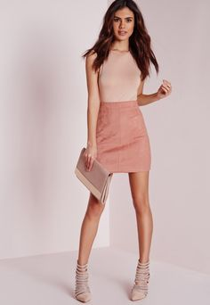A corduroy mini skirt featuring an A-line silhouette, a faux suede ...