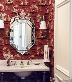 Michael S. Smith selected Shanghai Deco wallpaper in red from Clarence House to add a fanciful touch in a Santa Monica home's powder room. Click through for more of the best bathroom colors and paint color schemes for bathrooms.
