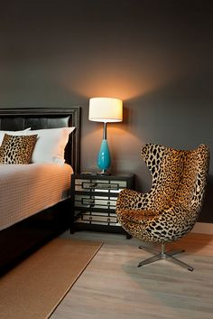 modlin modern master bedroom | leopard chair | mirrored nightstand | black leather bed | charcoal gray walls | photo by jeremy enlow | 360 west magazine august 2012
