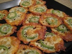 "Low Carb ""Jack Snacks""  Super simple - cheddar jack cheese & thin slice of jalapeno in the oven at 350"