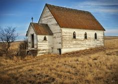 "CANADA | Abandoned church, Neidpath, Saskatchewan | Trevor & Rachel Olson | ""Neidpath was a town that sprang up in the early 1900's and was named after Neidpath Castle of Peebles, Scotland. As a point of interest Neidpath is now on the list for 'Places with fewer than 10 residents', 'Ghost towns of Canada' and 'Ghost towns of Saskatchewan'. It was in Neidpath that we found these great abandoned grain elevators, an old church, and remnants of a once great car."""
