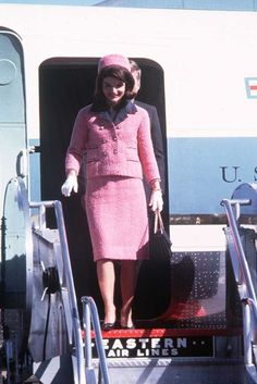 Jackie Kennedy arriving at Love Field in Dallas on November 22, 1963....The First Lady's pink suit and pillbox hat from that day went down in history for all the wrong reasons. She wore the statement feminine outfit the day her husband President John F. Kennedy was assasinated. It went on to represent to Americans the day the country went from hope and optimism to shock and despair. Jackie became a widow at the young age of 34 with two small children, Caroline, age 6 and John, Jr. age 3.