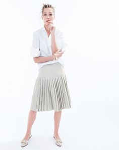 J.Crew women's stretch perfect shirt, drop waist pleated skirt in super 120s, open tube bracelet and collins basketweave loafers. To preorder call 800 261 7422 or email verypersonalstylist@jcrew.com.