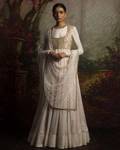 Sabyasachi is the one designer whose designs are being worn by in India and Pakistan. So if you want to wear a wedding dress go for Anarkali dresses designed by him White Anarkali, Anarkali Dress, Pakistani Dresses, Indian Dresses, Indian Outfits, Lehenga Choli, Anarkali Suits, Churidar Suits, Ethnic Outfits
