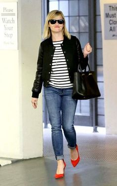 Reese Witherspoon wearing Ray-Ban Original Wayfarer Rb2140 Sunglasses in Black, The Row Small Day Luxe Leather Tote and By Malene Birger Red Atenera Suede Court Shoes.