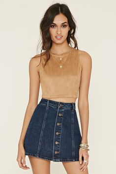 This sleeveless crop top is crafted from faux suede and is complete with an exposed back zipper.