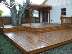 With steps that span the entire deck, a deck level change, partial rails and a small pergola help define the space and traffic patterns. Patio Deck Designs, Patio Design, Backyard Patio, Backyard Landscaping, 2 Tier Deck Ideas, 2 Level Deck Ideas, Platform Deck, Tiered Deck, Deck Pictures