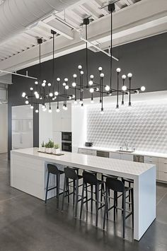 What Better Way To Illuminate Your Kitchen Than With Bright Chandeliers And  A White Themed Interior Design