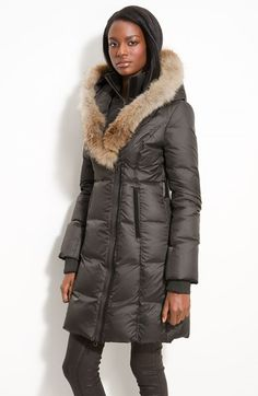 Free shipping and returns on Mackage Down Puffer with Coyote Fur Trim at Nordstrom.com. A face-framing ruff of genuine coyote fur tops a hooded puffer with tonal leather trim accenting the lustrous shell. A vest-front inner layer zips up through the rib-knit collar for added warmth.