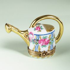 Limoges watering can with roses