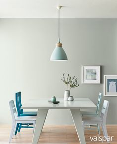 Sync your simpler, pared-down lifestyle with the kind of color Scandinavians have always loved: soft silver sage. Here it mixes with clean lines, minty greens and an on-trend teal to create a dining room that's simply stunning. Paint Color: Valspar Smoke Infusion at Lowe's, Valspar Rock Solid at Ace and at Independent Retailers.  https://www.askval.com/ColorsOfTheYearLanding/Soft-Silver-Sage