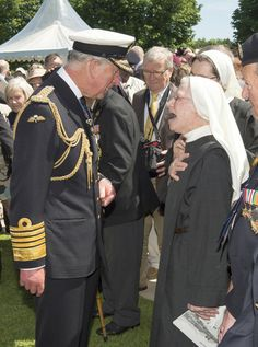 Prince Charles, Prince of Wales meets with nuns at Bayeux Cemetary during D-Day 70 Commemorations on June 6, 2014 in Bayeux, France.