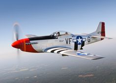 Red Nose P-51D, Tail # 473843, painted with WWII victory stripes.