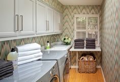 Holly Bender Interiors: Long, narrow laundry room with Osborne & Little Volte Wallpaper. Gray overlay laundry ...