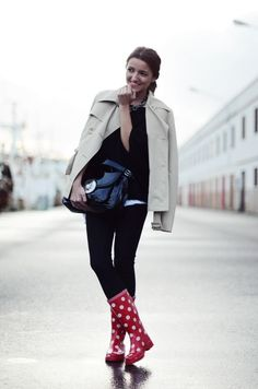 Shop this look on Lookastic:  http://lookastic.com/women/looks/rain-boots-leggings-satchel-bag-trenchcoat-oversized-sweater/9705  — Red Polka Dot Rain Boots  — Black Leggings  — Black Leather Satchel Bag  — Beige Trenchcoat  — Black Oversized Sweater