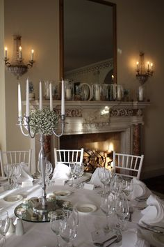 Tall silver candelabras with gypsophila flowers arrangement by Wild Rubus
