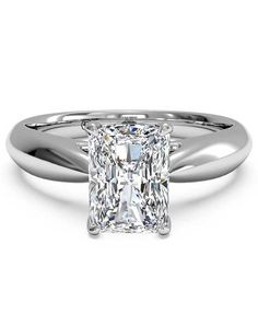 The X represents a kiss, and the round O of the ring band represents an endless embrace. Center stone secured by platinum ring prongs. Price excludes center stone