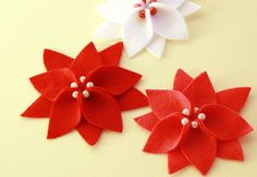 Felt Poinsettia Flowers by TranquilityKnots, via Flickr