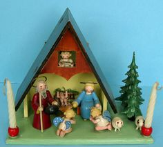 """German nativity music box all made of wood, musical instrument in the box at the back to be activated by turning the key, melody """"Holy Night"""", only the figure of Jozef is stamped """"Made in Germany"""";  completely handmade, probably Erzgebirge region judging by the way the figures and angels are made, probably Steinbach;  dimensions 17cm high, green base is 20cm x 11cm, but total depth incl. the instrument box 14,5cm."""