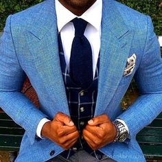 Pair a light blue blazer with dark grey suit pants for a sharp classy look.