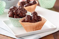 Chocolate-coated mini marshmallows are dropped onto baking sheets in clusters and chilled to form these easy, scrumptious two-ingredient treats.