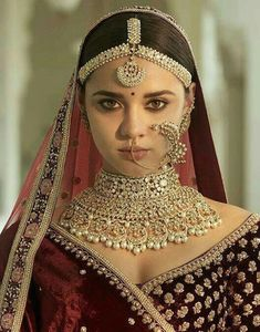 The quintessential Sabyasachi Bridal Jewelry crafted in gold with uncut diamonds and South Sea Pearl detailing. Paired with a beautiful… Indian Bridal Lehenga, Indian Bridal Makeup, Indian Bridal Outfits, Indian Bridal Fashion, Indian Wedding Jewelry, Indian Jewelry, Indian Weddings, Bridal Looks, Bridal Style