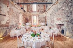 Banquet wedding reception inside the medieval castle - Vintage YSL Skirt For A Colourful 20s Inspired Wedding At The Lulworth Estate Dorset With Groom In Moss Bros. Suit And Images By One Thousand Words Wedding Photographers