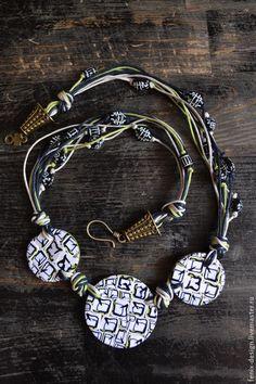 Polymer clay necklace by Fenix.
