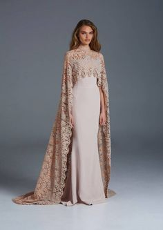 The classic cape is making a come back in a major way! Dress: Paolo Sebastian