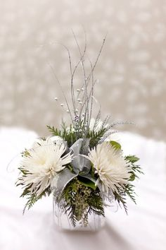 Top 18 Beautiful Christmas Wedding Centerpieces Ideas Married in Christmas? There are many benefits to getting married in this Christmas atmosphere. One of them is by combining elements of Christmas decorations at a wedding. There are many sp… Christmas Wedding Centerpieces, Winter Centerpieces, Floral Centerpieces, Christmas Decorations, Centrepieces, Winter Wonderland Centerpieces, Graduation Centerpiece, Quinceanera Centerpieces, Tall Centerpiece