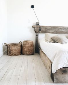 bedroom: old timber, white linen, white washed floorboards More