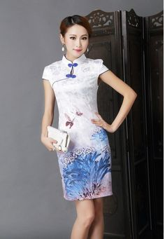 Dark Blue Peacock Cheongsam - The beautiful peacock print gives a stunning twist…