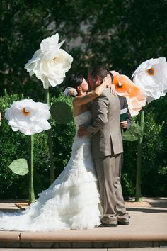 Oversize paper flowers at ceremony