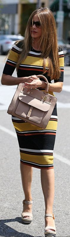 Sofía Vergara: Sunglasses – Tom Ford  purse – Fontana Milano  Dress – Wyatt