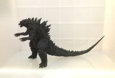 The S.H. Monsterarts Godzilla 2014 toy figure, masterfully sculpted by Yuji Sakai based on the 2014 movie version of Legendary's Godzilla. This is a perfect Godzilla figure, not considering the sloppiness paint of teeth and squint eyes.