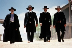 Val Kilmer as Doc Holiday, Sam Elliott as Virgil Earp, Kurt Russell as Wyatt Earp, and Bill Paxton as Morgan Earp:  The three-piece suit done right in the 19th century American West.