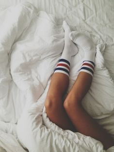 Sporty socks and tan legs