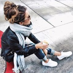 Consider wearing a black leather motorcycle jacket and navy ripped skinny jeans to create a chic, glamorous look. Dress down your look with white low top sneakers. Shop this look on Lookastic: https://lookastic.com/women/looks/black-biker-jacket-navy-skinny-jeans-white-low-top-sneakers/18812 — Grey Scarf — Black Leather Biker Jacket — Navy Ripped Skinny Jeans — White Low Top Sneakers