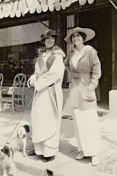 """1913, Gabrielle """"Coco"""" Chanel and her aunt in front of Chanel's first boutique."""