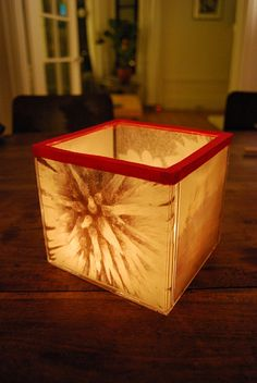 Votive cube from old CD cases. This uses photos printed on vellum. Markers and tissue paper could also work.