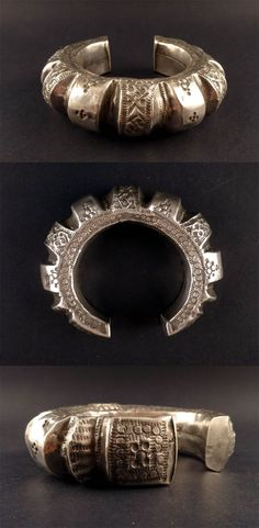 Baluchistan   Hollow silver Bedouin bracelet; repousée and engraved work, with abstract motifs.    Sold