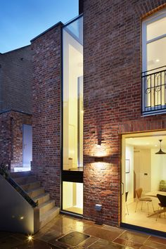 A sliver of glazing inserted between the back of this west London house and its brick extension is illuminated by lighting at night Brick Extension, Glass Extension, Contemporary Windows, Modern Windows, Architecture Design, Amazing Architecture, Computer Architecture, Glass Brick, Architectural Services