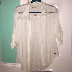 Hollister white lace button down shirt A cute, white button down with a see-through lace back, never worn and still with tags. Price is negotiable and feel free to ask questions:) Hollister Tops Button Down Shirts