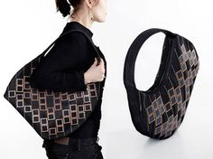 """Now solar panels are not restricted to your rooftop only. They now come embedded in our purse also by the Danish design studio Diffus. The purse has a """"century of solar sequins"""" on its surface. The sequins are embedded in beautiful geometrical shapes, and these sequins are capable of generating as much as 2 watts of power in the daytime. You can easily charge your portable. Once the sun sets, the leftover energy does not get wasted. Optical Fibers Glow whenever you open the purse."""