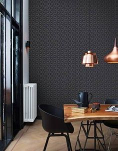 Dark patterned wallpaper for a high ceilinged dining area.