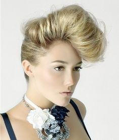 Beauty Dare: The Pompadour.  It was first seen on guys like James Dean & Elvis Presley, now female are sporting the pompadour. It's a piled-up-high-above-the-hairline coif.  So next time you want to pull your hair off your neck, skip the ponytail and the topknot—go for the pompadour. I double dog dare you!  www.terrabacio.com